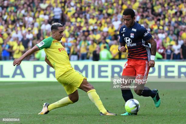 Nantes' BelgianMoroccan mildfielder Yassine EL Ghanassy vies for the ball with Lyon's Dutch forward Memphis Depay during the French L1 football match...