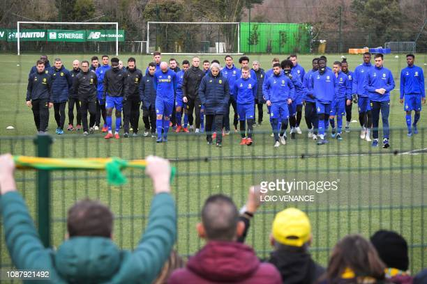 Nantes' Bosnian head coach Vahid Halilhodzic and players arrive to talk with supporters at the FC Nantes football club training centre La Joneliere...