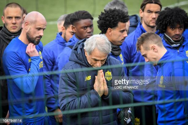 Nantes' Bosnian head coach Vahid Halilhodzic and players talk with supporters at the FC Nantes football club training centre La Joneliere in La...