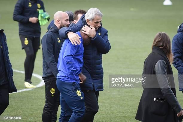 TOPSHOT Nantes' Bosnian head coach Vahid Halilhodzic comforts Nantes' Ghanaian forward Majeed Waris prior to a team training session at the FC Nantes...