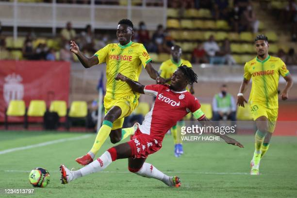 Nantes' Brazilian defender Andrei Girotto fights for the ball with Monaco's French defender Axel Disasi during the French L1 football match between...