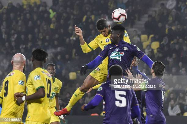 Nantes' Brazilian defender Diego Carlos heads the ball during the French Cup football match between FC Nantes and Toulouse FC at La Beaujoire stadium...