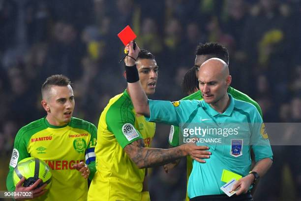 TOPSHOT Nantes' Brazilian defender Diego Carlos receives a red card from French referee Tony Chapron during the French L1 football match between...