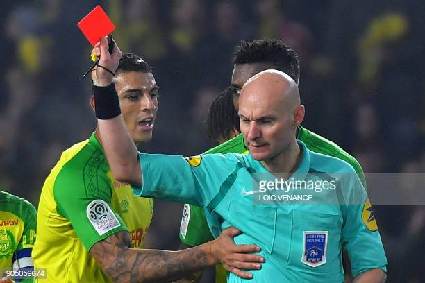 Nantes' Brazilian defender Diego Carlos receives a red card from French referee Tony Chapron during the French L1 football match between Nantes and...