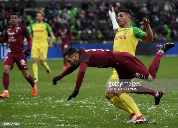 Nantes' Brazilian defender Diego Carlos vies with Metz' French midfielder Danijel Milicevic during the French L1 football match Metz vs Nantes on...
