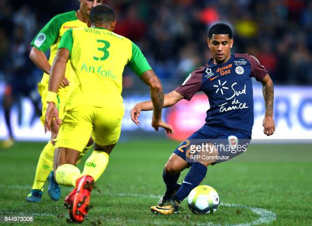 Nantes' Brazilian defender Diego Carlos vies with Montpellier's South African forward Keagan Dolly during the French L1 football match between...