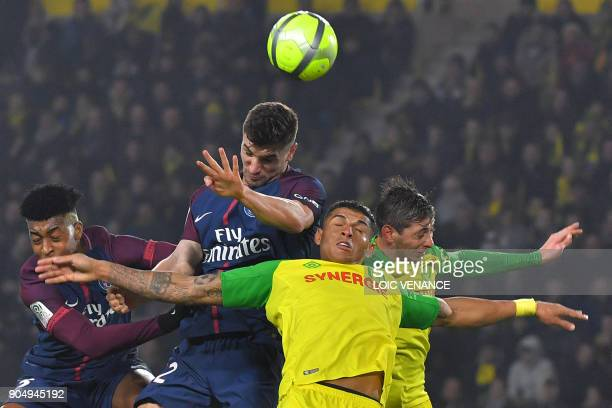 TOPSHOT Nantes' Brazilian defender Diego Carlos vies with Paris SaintGermain's Spanish forward Jese during the French L1 football match between...