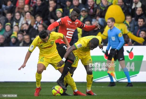 Nantes' Brazilian defender Fabio Da Silva and his teammate Ghanean forward Majeed Waris vie with Rennes' Senegalese forward M'Baye Niang during the...