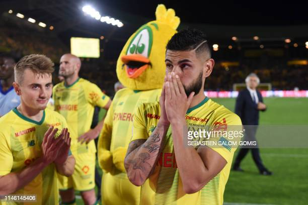 Nantes' Brazilian defender Lima gestures as Nantes players thank their supporters during the French L1 football match between FC Nantes and...