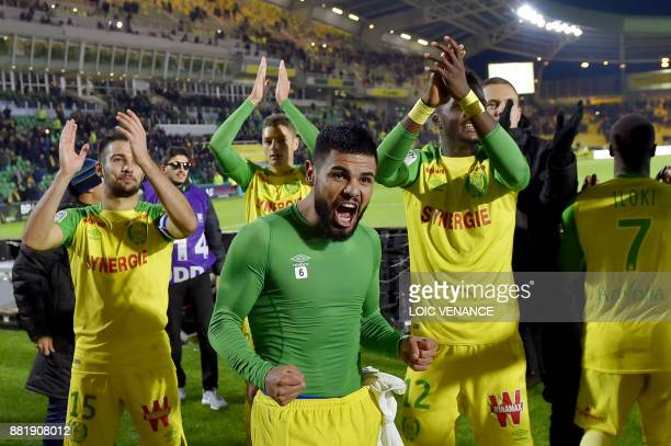Nantes' Brazilian defender Lucas Lima celebrates with teammates at the end of the French L1 football match Nantes vs Monaco at the La Beaujoire...
