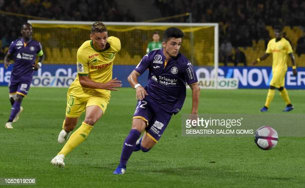 Nantes' Brazilian midfielder Andrei Girotto fights for the ball with Toulouse's Spanish midfielder Manu Garcia Alonso during the French L1 football...