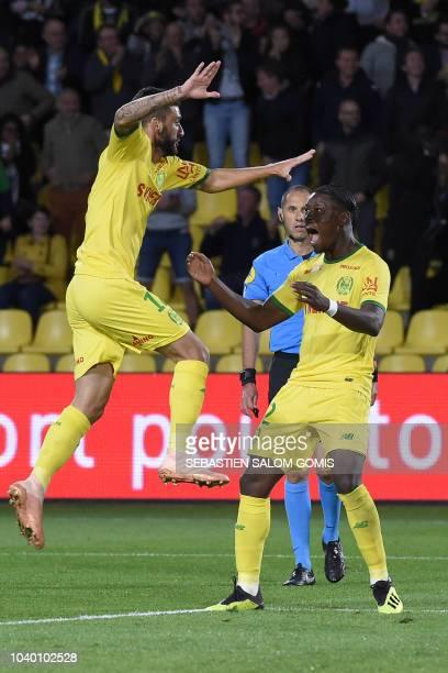 Nantes' Brazilian midfielder Gabriel Boschilia and Nantes' Belgian forward Anthony Limbombe celebrate their team's goal by Nantes' Argentine forward...
