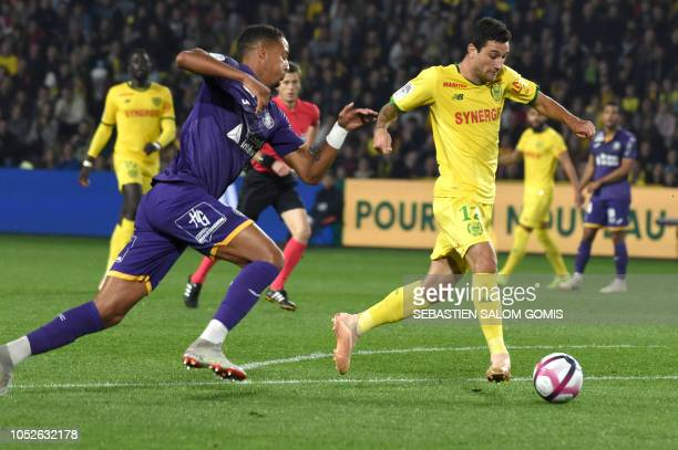 Nantes' Brazilian midfielder Gabriel Boschilia rus with the ball to score during the French L1 football match Nantes against Toulouse on October 20...
