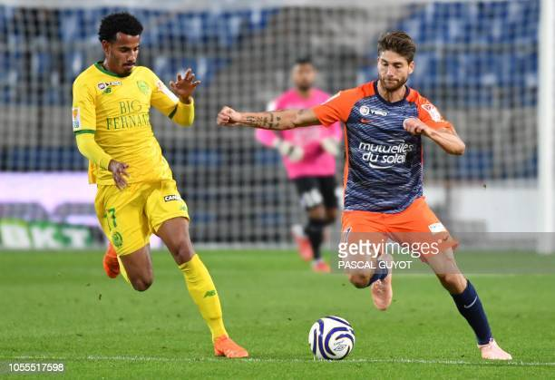 Nantes' Brazilian midfielder Lucas Evangelista fights for the ball with Montpellier's French midfielder Paul Lasne during the French League Cup...