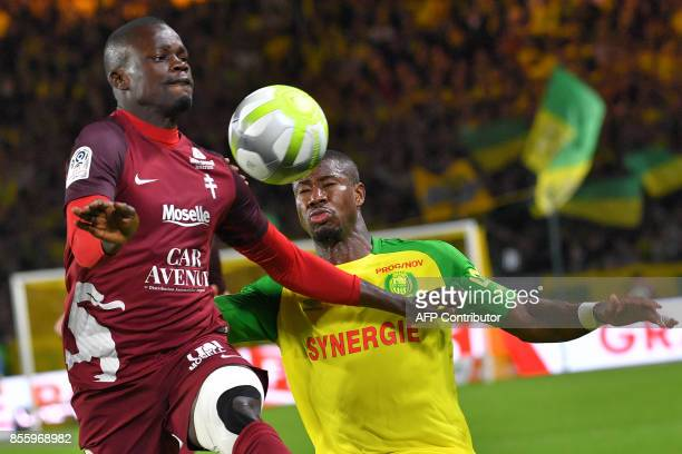 Nantes' Burkinabe forward Prejuce Nakoulma and Metz' Senegalese defender Fallou Diagne go for the ball during the French L1 football match Nantes vs...