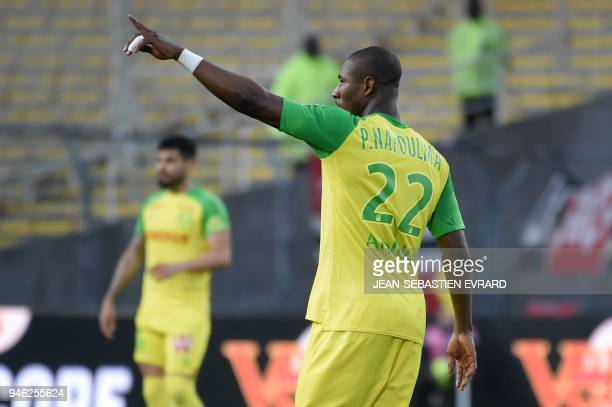 Nantes' Burkinabe forward Prejuce Nakoulma celebrates after scoring a goal during the French L1 football match between Nantes and Dijon on April 14...