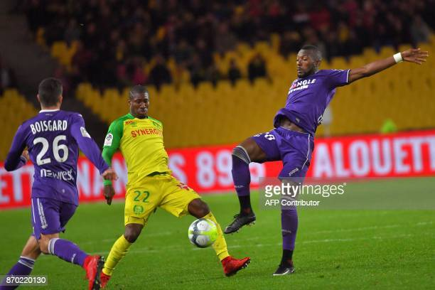 Nantes' Burkinabe forward Prejuce Nakoulma vies with Toulouse's French defender Issa Diop during the French L1 football match Nantes versus Toulouse...