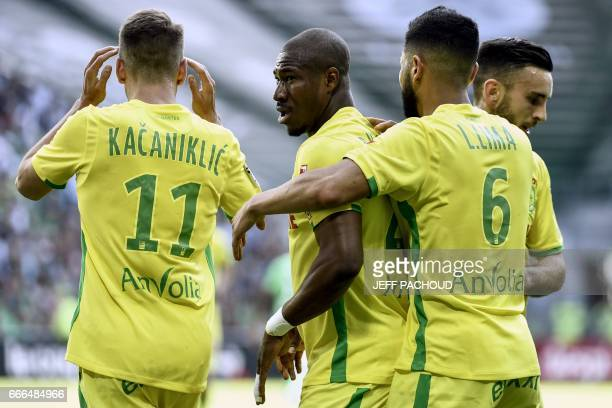 Nante's Burkinabese forward Prejuce Nakoulma celebrates with his teammates after scoring a goal during the French L1 football match between AS...