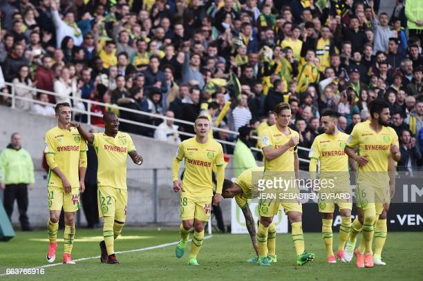 Nantes' Burkinabese forward Prejuce Nakoulma celebrates with his teammates during the French L1 football match between Nantes and Angers on April 2...