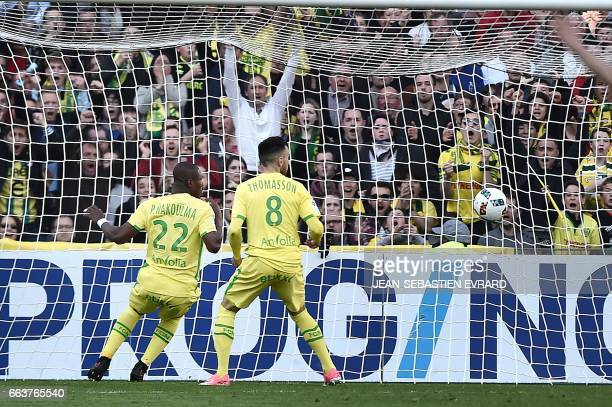 Nantes' Burkinabese forward Prejuce Nakoulma scores during the French L1 football match between Nantes and Angers on April 2 2017 at the Beaujoire...