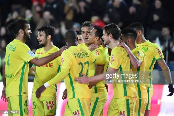 Nantes' Colombian forward Felipe Pardo celebrates with his teammates after scoring during the French L1 football match between Nantes and Dijon on...