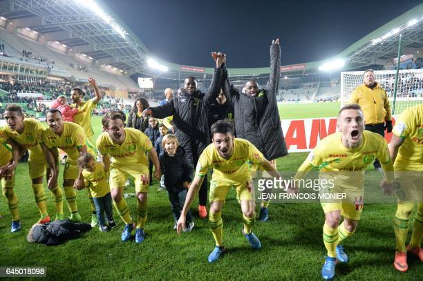 Nantes' Colombian forward Felipe Pardo Nantes' French defender Leo Dubois Nantes' French midfielder Valentin Rongier teammates and staff celebrate...
