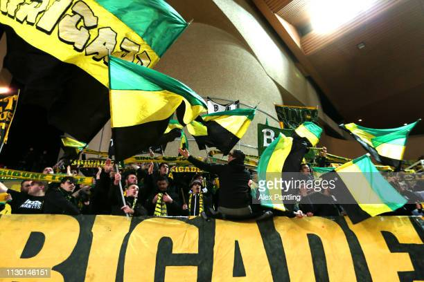 Nantes fans show their support during the Ligue 1 match between AS Monaco and FC Nantes at Stade Louis II on February 16, 2019 in Monaco, Monaco.