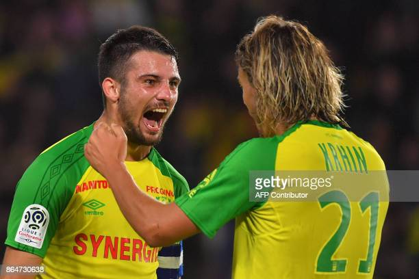 Nantes' French defender and captain Leo Dubois celebrates with Nantes' Slovenian midfielder Rene Krhin after winning the French L1 football match...