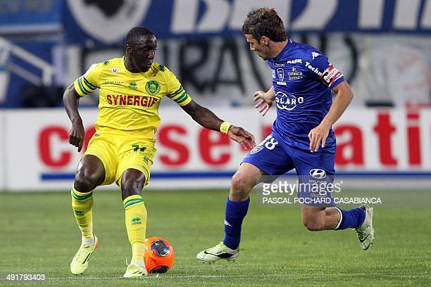 Nantes' French defender Issa Cissokho vies with Bastia's French midfielder Yannick Cahuzac during the French L1 football match Bastia against Nantes...