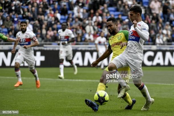 Nantes' French defender Koffi Djidji vies with Lyon's forward Houssem Aouar during the French L1 football match Olympique Lyonnais vs FC Nantes on...