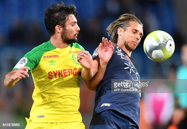 Nantes' French defender Leo Dubois vies with Montpellier's French forward Kevin Brigaud during the French L1 football match between Montpellier and...