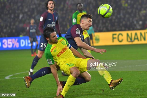 Nantes' French defender Leo Dubois vies with Paris SaintGermain's Belgian defender Thomas Meunier during the French L1 football match between Nantes...