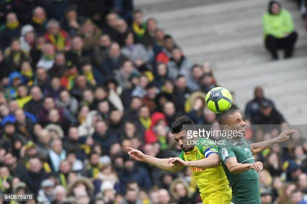 TOPSHOT Nantes' French defender Leo Dubois vies with SaintEtienne's French forward Kevin MonnetPaquet during the French L1 football match between...