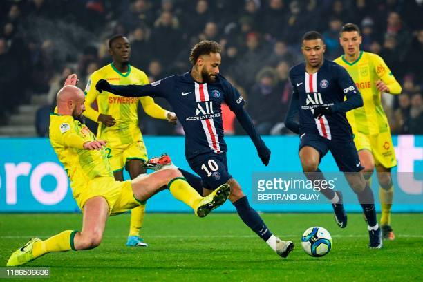 TOPSHOT Nantes' French defender Nicolas Pallois fights for the ball with Paris SaintGermain's Brazilian forward Neymar during the French L1 football...