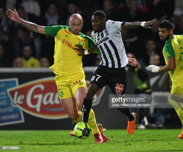 Nantes' French defender Nicolas Pallois vies with Angers' Cameroonian forward Karl Toko Ekambi during the French L1 football match between Angers SCO...