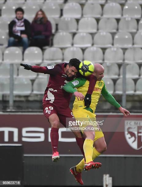 Nantes' French defender Nicolas Pallois vies with Metz' French forward Emmanuel Riviere during the French L1 football match between Metz and Nantes...