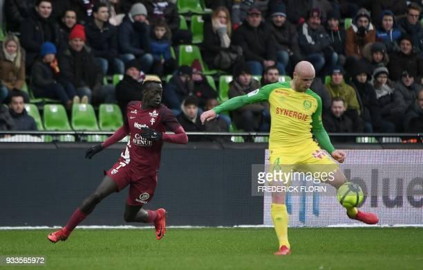 Nantes' French defender Nicolas Pallois vies with Metz' Senegalese forward Ibrahima Niane during the French L1 football match Metz vs Nantes on March...