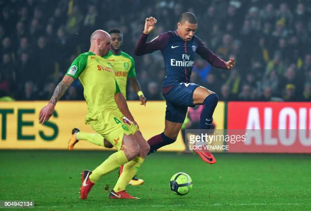 Nantes' French defender Nicolas Pallois vies with Paris SaintGermain's French forward Kylian Mbappe during the French L1 football match between...