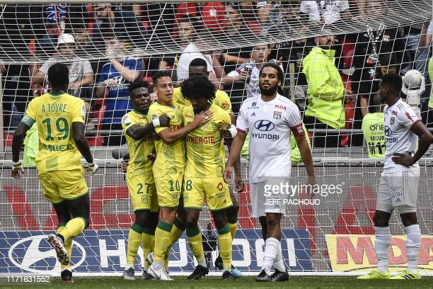 TOPSHOT Nantes' French defender Samuel Moutoussamy celebrates with his teamates after he scored a goal during the French L1 football match between...
