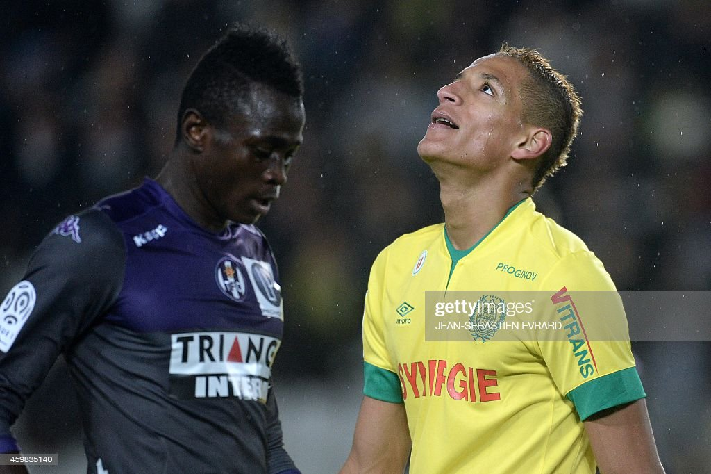 Nantes' French forward Yacine Bammou (R) reacts during the French L1 football match between Nantes (FCN) and Toulouse (TFC) on December 2, 2014 at the Beaujoire stadium in Nantes, western France.