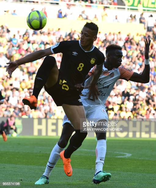 Nantes' French forward Yacine Bammou vies with Montpellier's French midfielder Junior Sambia during the French L1 football match Nantes vs...
