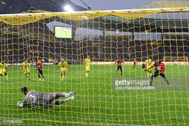 Nantes' French goalkeeper Alban Lafont stops the ball on a penalty kick executes by Rennes' Senegalese forward Mbaye Niang during the French L1...