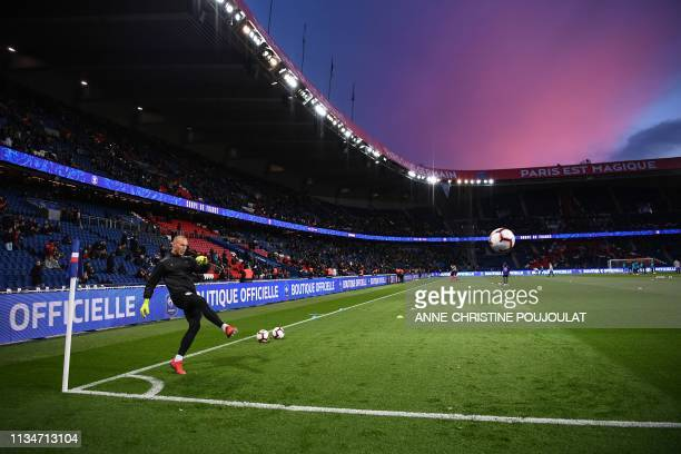 Nantes' French goalkeeper Maxime Dupe warms up before the French Cup semi-final football match between Paris Saint-Germain and FC Nantes at the Parc...