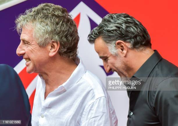 Nantes' French head coach Christian Gourcuff and Lille's French coach Christophe Galtier smile before the French L1 football match between Lille and...