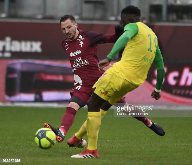 Nantes' French midfielder Abdoulaye Toure vies with Metz' French midfielder Danijel Milicevic during the French L1 football match Metz vs Nantes on...