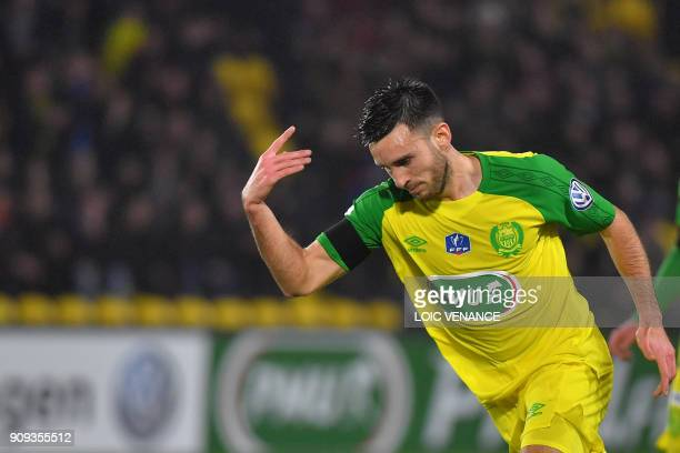 Nantes' French midfielder Adrien Thomasson celebrates after scoring a goal during the French Cup round of 32 football match FC Nantes vs AJ Auxerre...