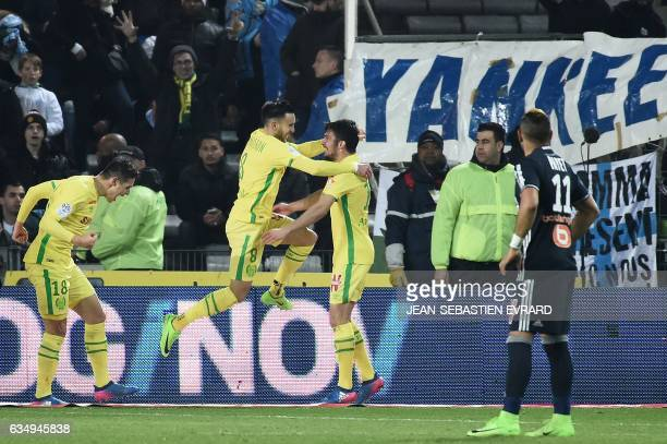 Nantes' French midfielder Adrien Thomasson celebrates after scoring during the French L1 football match between Nantes and Marseille at Beaujoire...