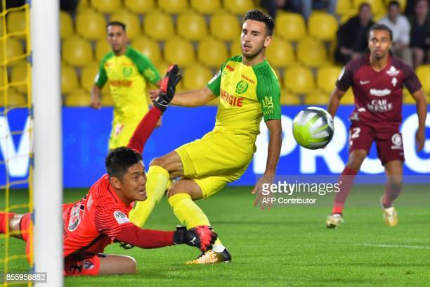 Nantes' French midfielder Adrien Thomasson confronts Metz' Japanese goalkeeper Eiji Kawashima during the French L1 football match Nantes vs Metz at...