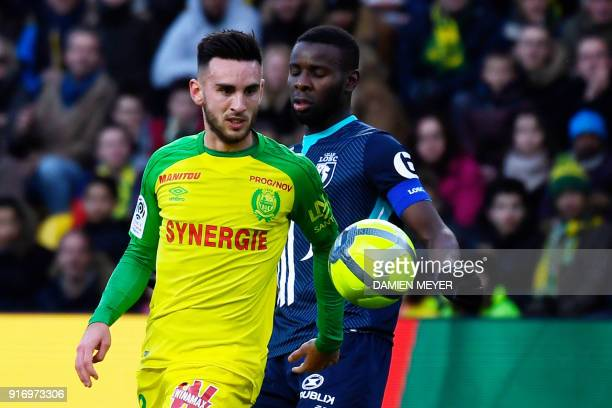 Nantes' French midfielder Adrien Thomasson vies with Lille's French midfielder Ibrahim Amadou during the French L1 football match between Nantes and...