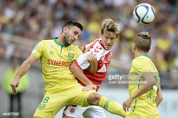 Nantes' French midfielder Adrien Thomasson vies with Reims' French defender Franck Signorino during the French L1 football match between Nantes and...